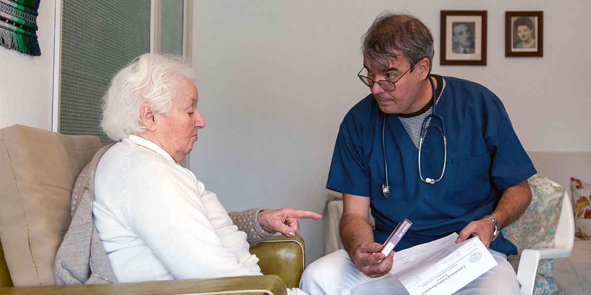 Doctor with elder patient