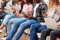 Young people on mobile devices
