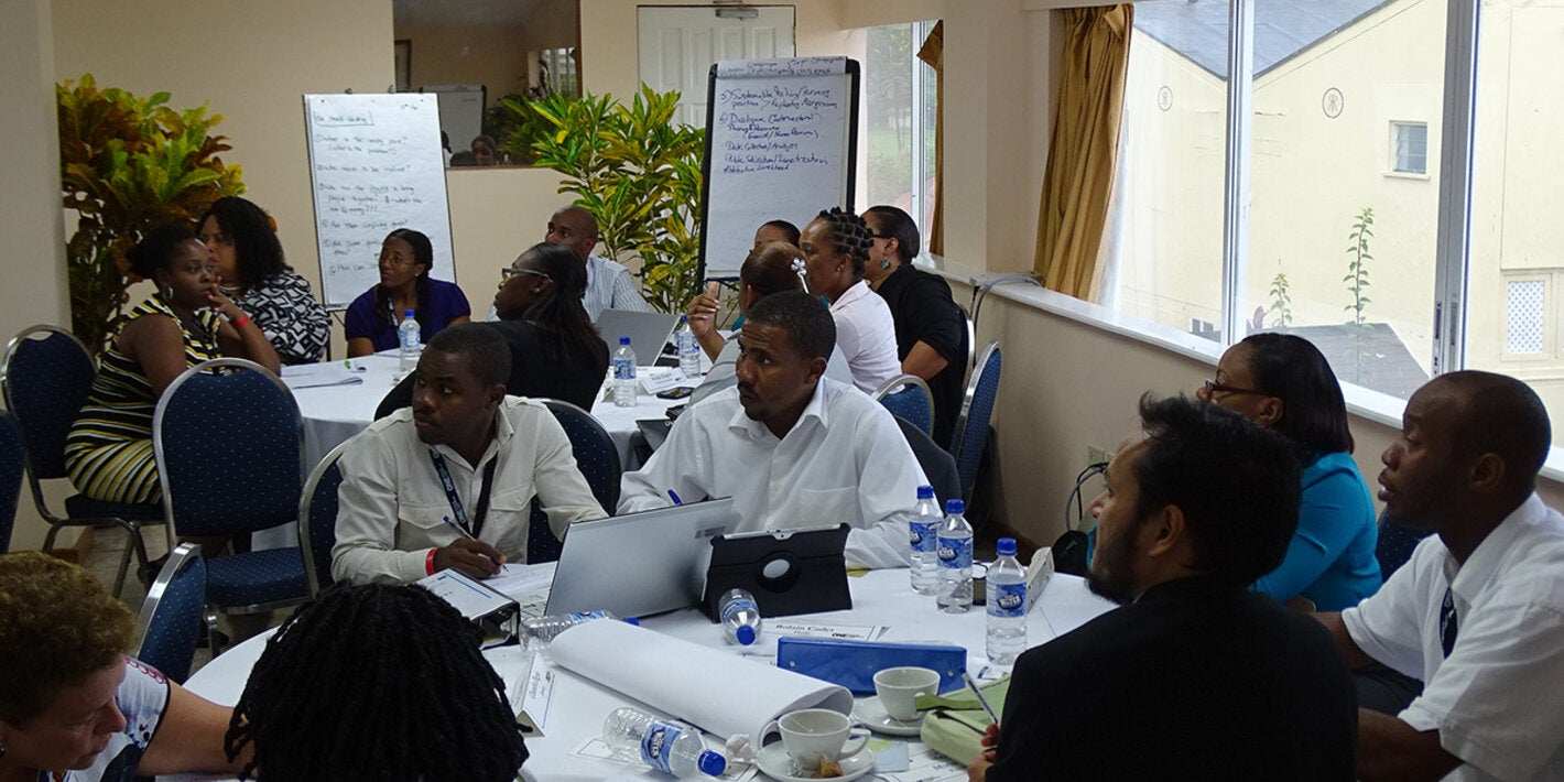 Caribbean participants work in groups.