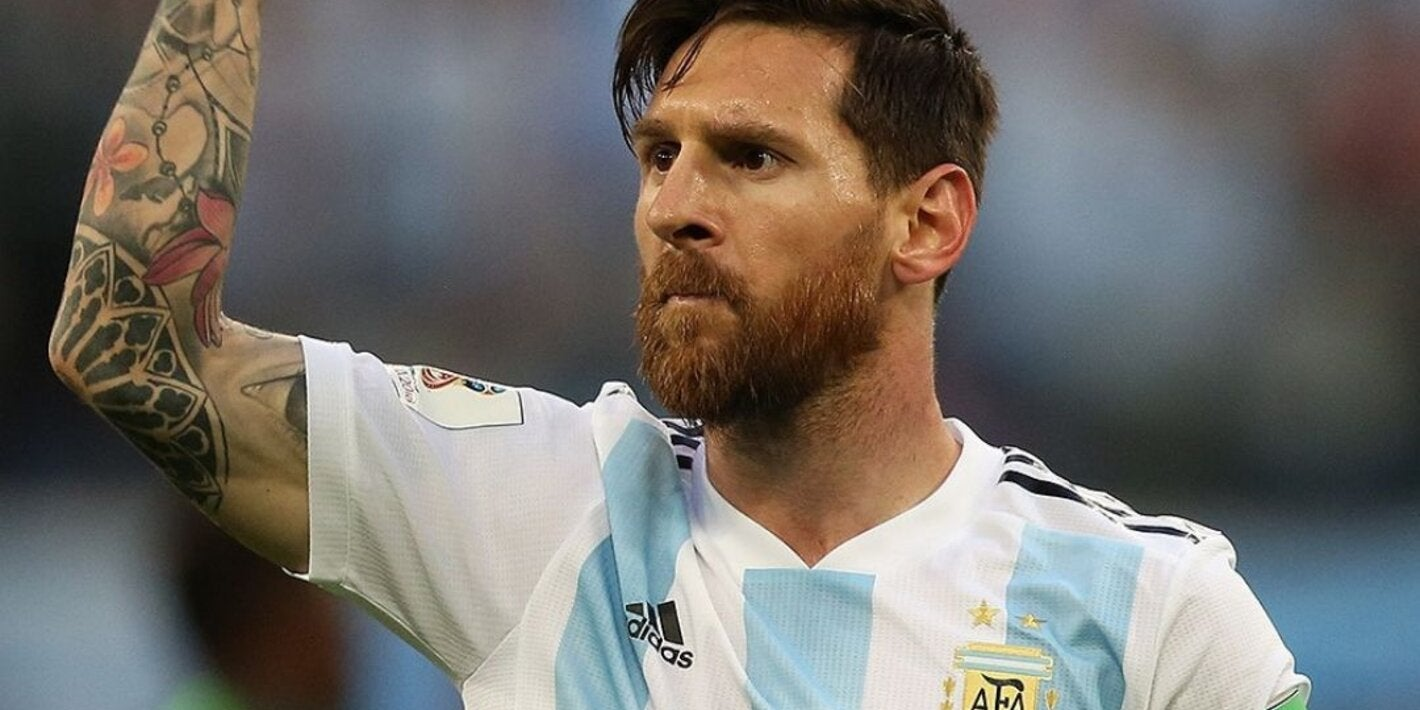 Lionel Messi with Argentinian soccer jersey clenching fist in the air