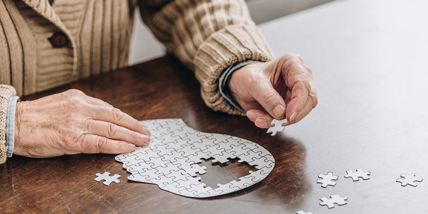 Old adult solving puzzle