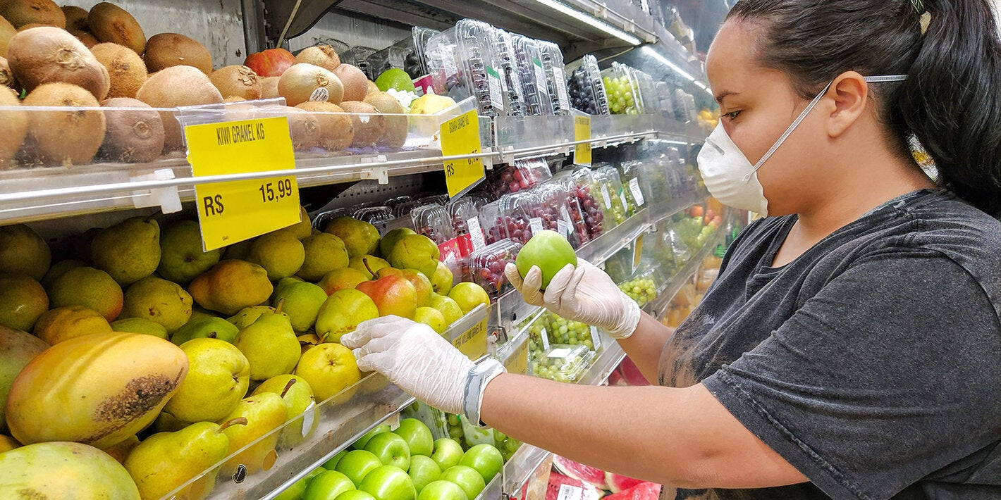 Woman buying fruit in a supermarket