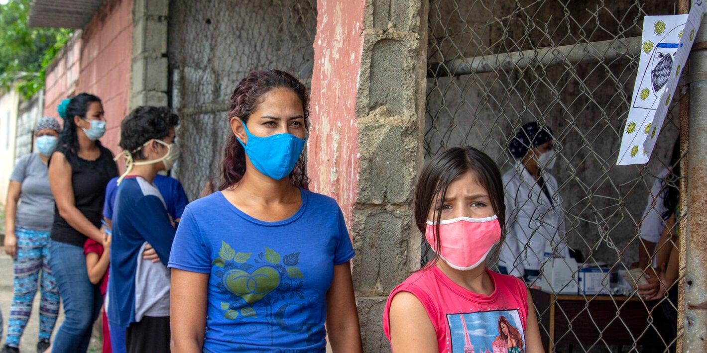People walking wearing masks