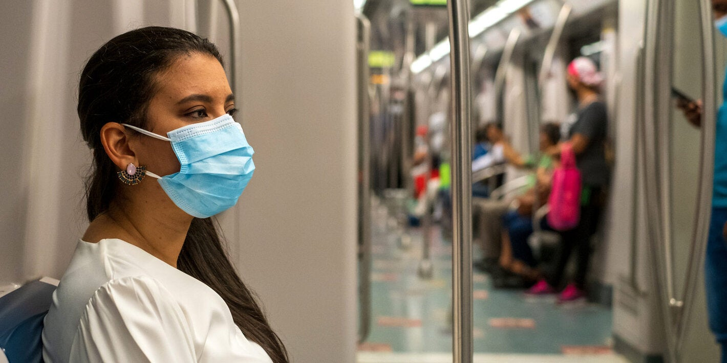 Woman wearing mask while using public transportation